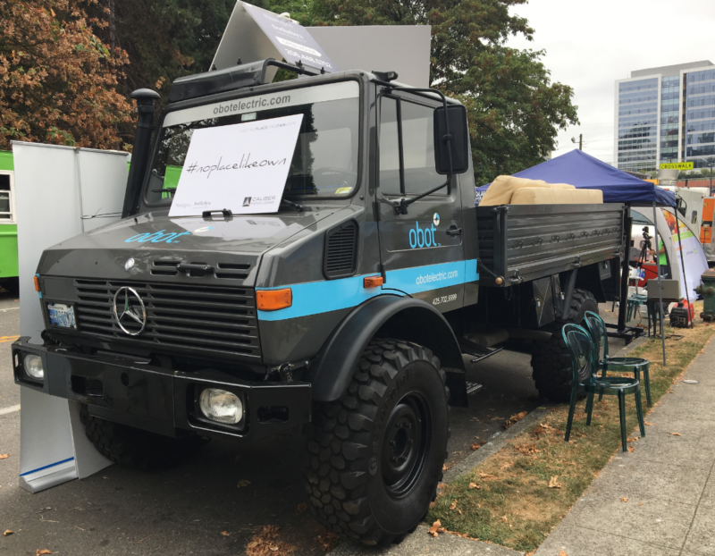 In keeping with the Food Truck theme, the Wipliance Unimog — a massive military grade vehicle provided the backdrop for the creative exhibit booth, which featured a living room set up on the bed of the truck.