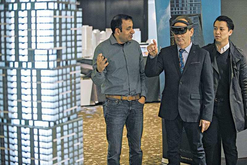 NEXUS architect Blaine Weber (wearing HoloLens set) views the virtual neighborhood.